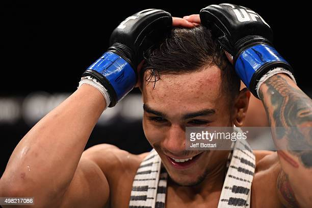 Andre Fili of the United States celebrates after his knockout victory over Gabriel Benitez of Mexico in their featherweight bout during the UFC Fight...