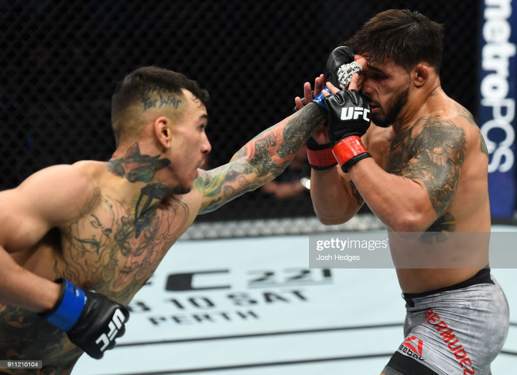 Andre Fili punches Dennis Bermudez in their featherweight bout during a UFC Fight Night event at Spectrum Center on January 27, 2018 in Charlotte, North Carolina.
