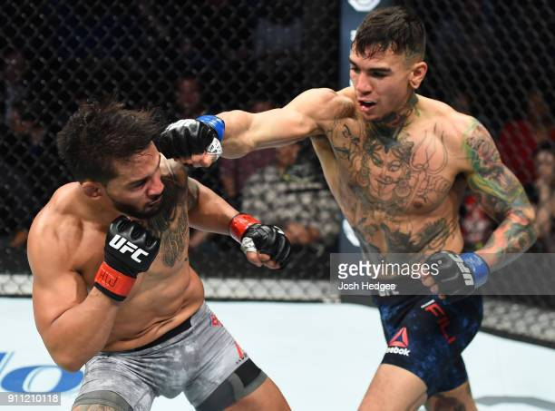 Andre Fili punches Dennis Bermudez in their featherweight bout during a UFC Fight Night event at Spectrum Center on January 27 2018 in Charlotte...