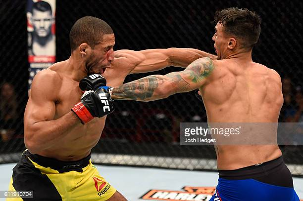 Andre Fili punches Hacran Dias of Brazil in their featherweight bout during the UFC Fight Night event at the Moda Center on October 1 2016 in...