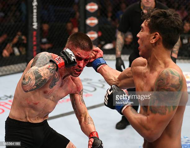 Andre Fili punches Jeremy Larsen in their UFC featherweight bout at the Toyota Center on October 19 2013 in Houston Texas