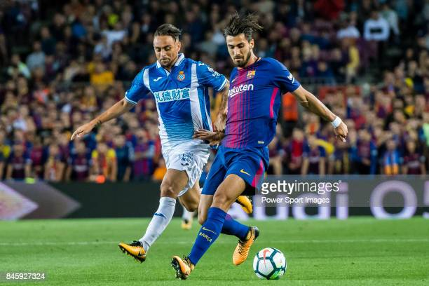 Andre Filipe Tavares Gomes of FC Barcelona fights for the ball with Sergio Garcia de la Fuente of RCD Espanyol during the La Liga match between FC...