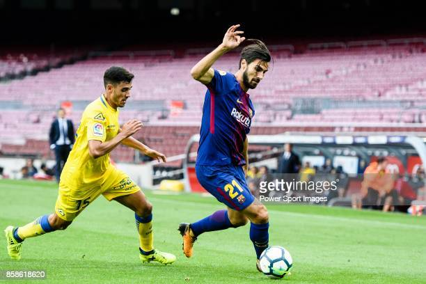 Andre Filipe Tavares Gomes of FC Barcelona in action against Borja Herrera Gonzalez of UD Las Palmas during the La Liga 201718 match between FC...