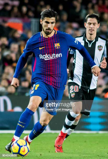 Andre Filipe Tavares Gomes of FC Barcelona is followed by Sasa Lukic of Levante UD during the La Liga 201718 match between FC Barcelona and Levante...