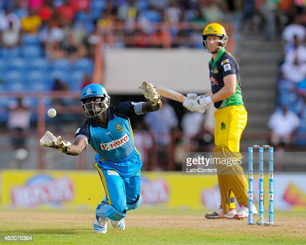 Andre Fletcher of St Lucia Zouks attempts to catch an throw from Adam Voges of Jamacia Tallawahs during a match between St Lucia Zouks and Jamaica...