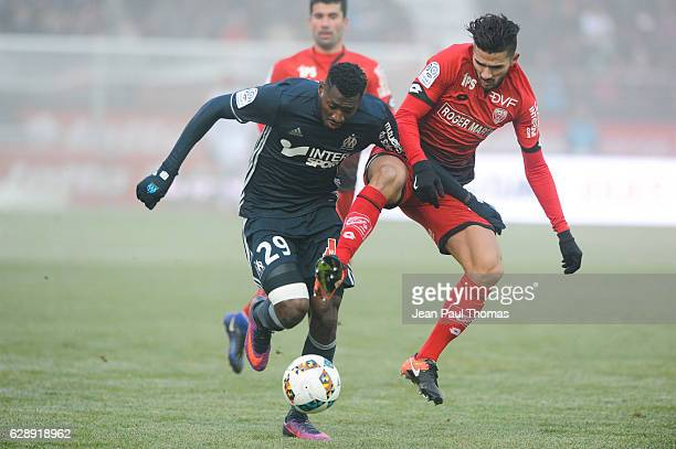 Andre Frank ZAMBO ANGUISSA of Marseille and Mehdi ABEID of Dijon during the French Ligue 1 between Dijon and Marseille at Stade Gaston Gerard on...