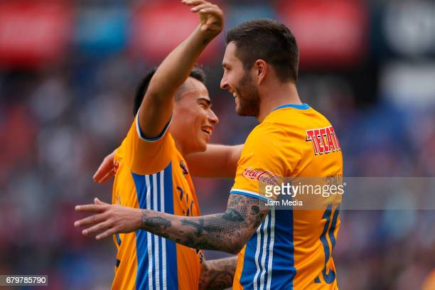 Andre Gignac of Tigres celebrates after scoring a goal with teammate Lucas Zelarayan during a match between Queretaro against Tigres as part of the...