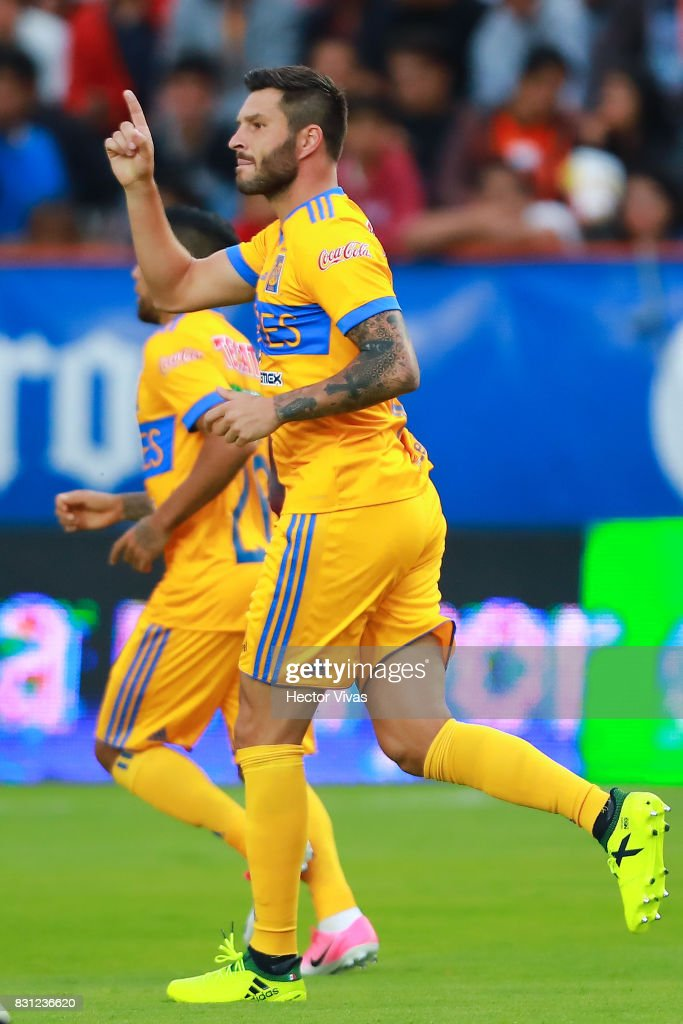 Andre Gignac of Tigres celebrates with after scoring the first goal of his team during the 4th round match between Pachuca and Tigres UANL as part of the Torneo Apertura 2017 Liga MX at Hidalgo Stadium on August 12, 2017 in Pachuca, Mexico.