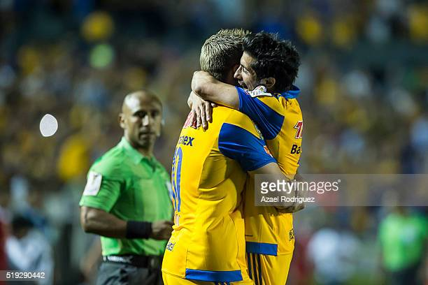 Andre Gignac of Tigres celebrates with teammate Damian Alvarez after scoring his team's second goal during the semifinals second leg match between...