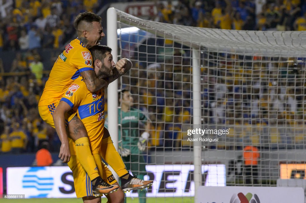 Andre Gignac of Tigres celebrates with teammate Eduardo Vargas after scoring his team's second goal during the 5th round match between Tigres and Pumas as part of the Torneo Apertura 2017 Liga MX at Universitario Stadium on August 19, 2017 in Monterrey, Mexico.