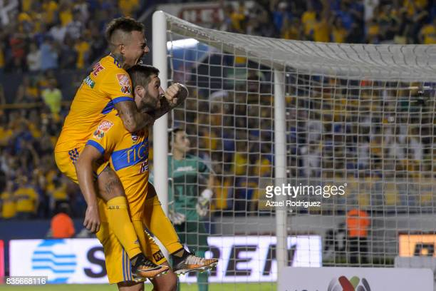 Andre Gignac of Tigres celebrates with teammate Eduardo Vargas after scoring his team's second goal during the 5th round match between Tigres and...