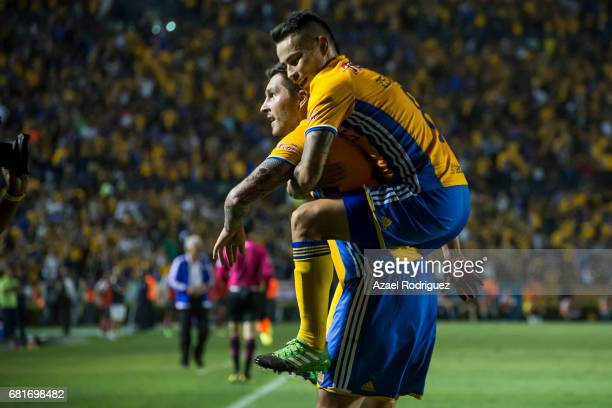 Andre Gignac of Tigres celebrates with teammate Lucas Zelarayan after scoring his team's third goal during the quarter finals first leg match between...