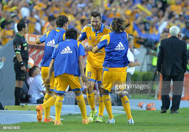 Andre Gignac of Tigres celebrates with teammates after scoring the opening goal during a semifinal second leg match between Tigres UANL and...