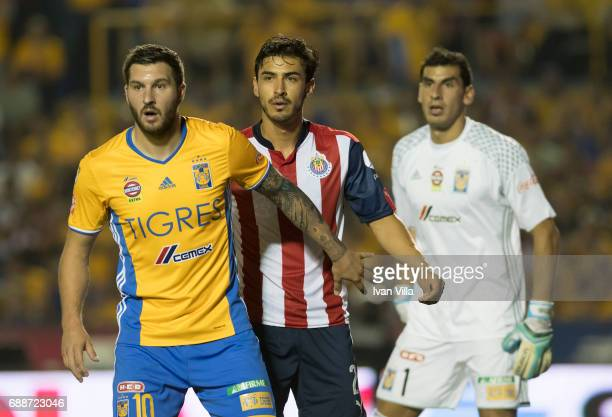 Andre Gignac of Tigres Osvaldo Alanis of Chivas and Nahuel Guzman of Tigres gesture during the Final first leg match between Tigres UANL and Chivas...