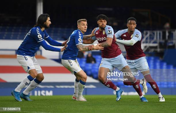 Andre Gomes and Lucas Digne of Everton compete for a corner ball with Tyrone Mings and Ezri Konsa of Aston Villa during the Premier League match...