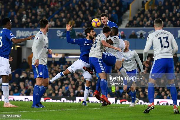 Andre Gomes and Michael Keane of Everton make an aerial challenge during the Premier League match between Everton and Cardiff City at Goodison Park...