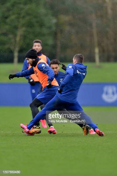 Andre Gomes challenges for the ball with Dominic Calvert-Lewin and Morgan Schneiderlin during the Everton training session at USM Finch Farm on...