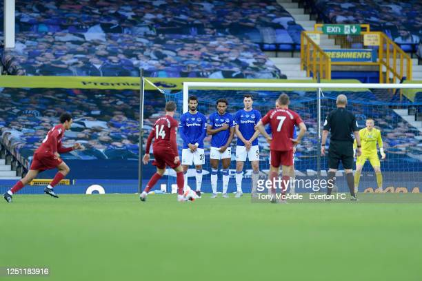 Andre Gomes, Dominic Calvert-Lewin and Michael Keane of Everton form a wall as Liverpool take a free kick during the Premier League match Everton and...