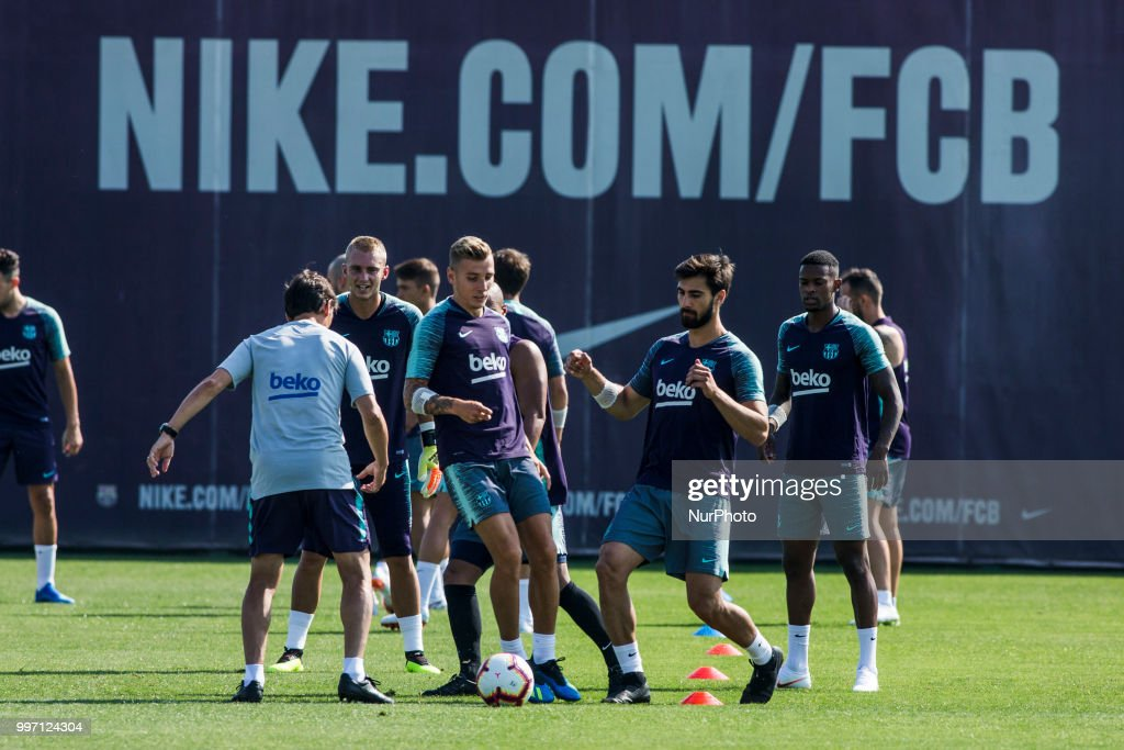 Andre Gomes from Portugal and Lucas Digne from France during the first FC Barcelona training session of the 2018/2019 La Liga pre season in Ciutat Esportiva Joan Gamper, Barcelona on 11 of July of 2018.