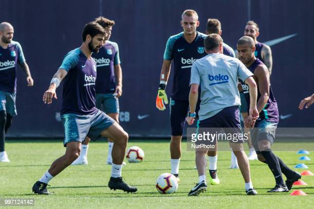 Andre Gomes from Portugal Jasper Cillessen from Holland and Rafinha Alcantara from Brasil during the first FC Barcelona training session of the...