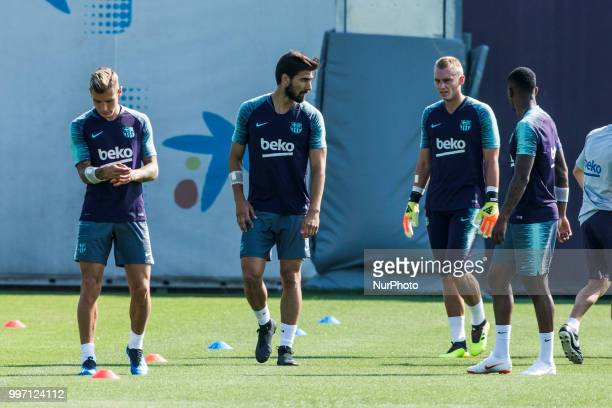 Andre Gomes from Portugal Lucas Digne from France and Jasper Cillessen from Holland during the first FC Barcelona training session of the 2018/2019...