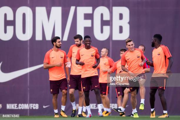 Andre Gomes Gerard Pique Ousmane Dembele Lucas Digne and Samuel Umtiti of FC Barcelona warm up during a training session ahead of the UEFA Champions...
