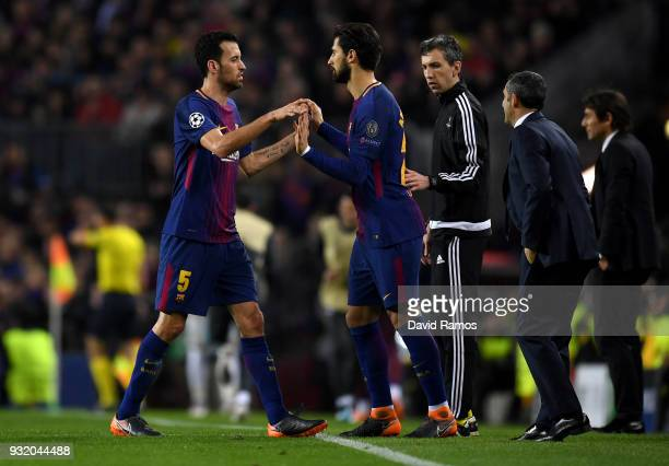 Andre Gomes of Barcelona comes on for Sergio Busquets of Barcelona during the UEFA Champions League Round of 16 Second Leg match FC Barcelona and...