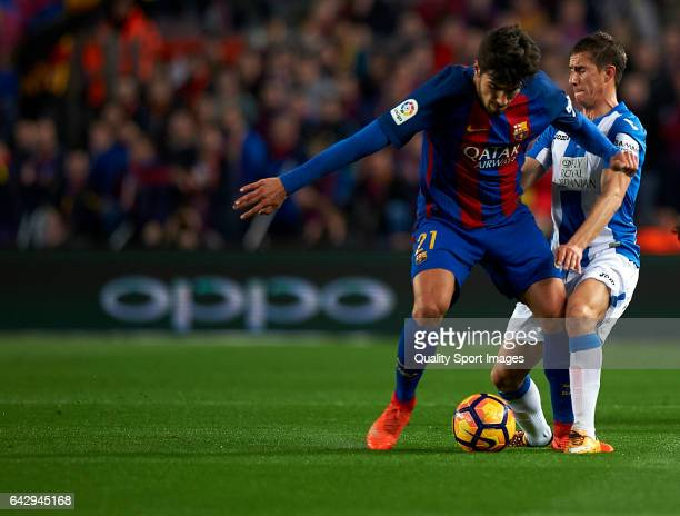 Andre Gomes of Barcelona competes for the ball with Alexander Szymanowski of Leganes during the La Liga match between FC Barcelona and CD Leganes at...