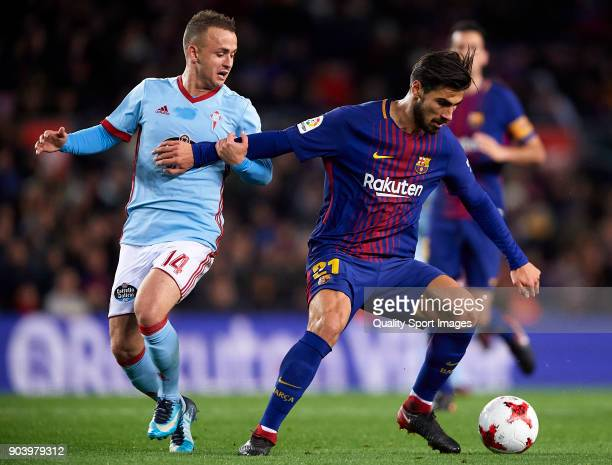 Andre Gomes of Barcelona competes for the ball with Lobotka of Celta during the Copa del Rey Round of 16 second Leg match between Barcelona and Celta...