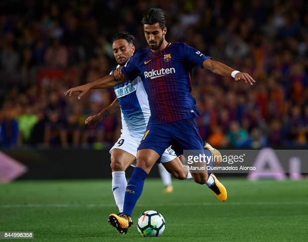 Andre Gomes of Barcelona competes for the ball with Sergio Garcia of Espanyol during the La Liga match between Barcelona and Espanyol at Camp Nou on...
