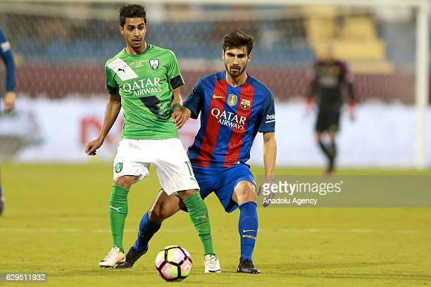 Andre Gomes of Barcelona in action against Housain Al-Mogahwi of Al-Ahli Saudi during a friendly soccer match between Al-Ahli Saudi and Barcelona at...