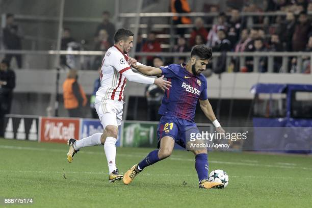 Andre Gomes of Barcelona in action against Omar Elabdellaoui of Olympiakos during a UEFA Champions League match between Olympiakos and Barcelona at...