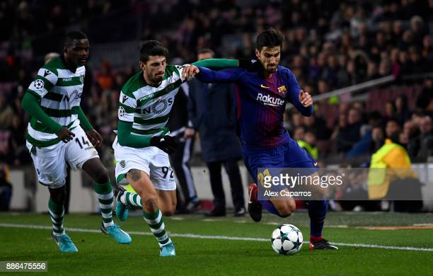 Andre Gomes of Barcelona is challenged by Cristiano Piccini of Sporting Lisbon during the UEFA Champions League group D match between FC Barcelona...