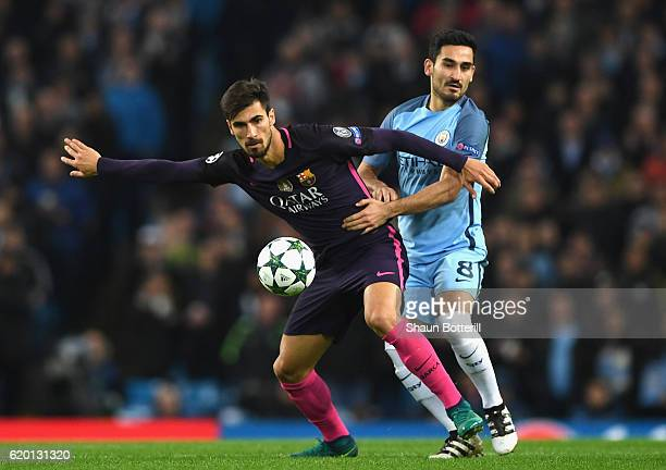 Andre Gomes of Barcelona is held by Ilkay Gundogan of Manchester City during the UEFA Champions League Group C match between Manchester City FC and...