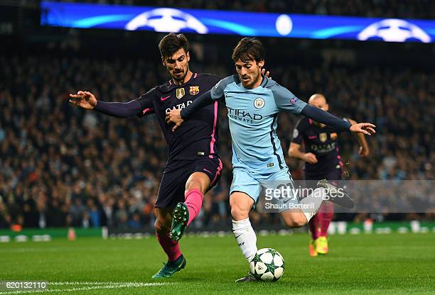 Andre Gomes of Barcelona puts pressure on David Silva of Manchester City during the UEFA Champions League Group C match between Manchester City FC...