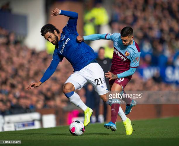 Andre Gomes of Everton and Manuel Lanzini of West Ham United in action during the Premier League match between Everton FC and West Ham United at...