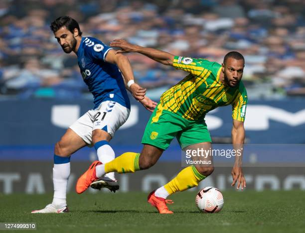 Andre Gomes of Everton and Matt Phillips of West Bromwich Albion in action during the Premier League match between Everton and West Bromwich Albion...