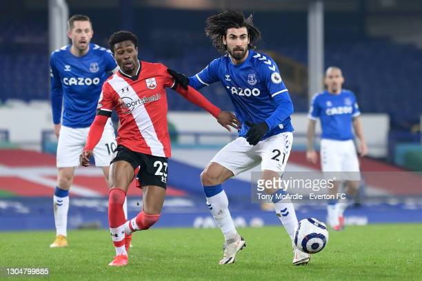 Andre Gomes of Everton and Nathan Tella challenge for the ball during the Premier League match between Everton and Southampton at Goodison Park on...