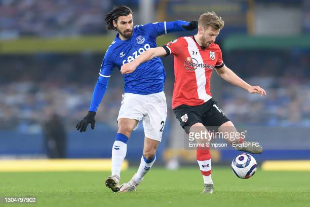 Andre Gomes of Everton and Stuart Armstrong challenge for the ball during the Premier League match between Everton and Southampton at Goodison Park...