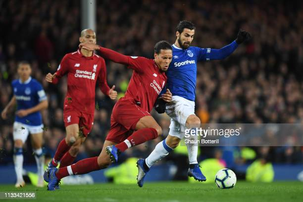 Andre Gomes of Everton and Virgil van Dijk of Liverpool battle for the ball during the Premier League match between Everton FC and Liverpool FC at...