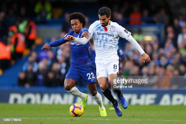 Andre Gomes of Everton and Willian of Chelsea battle for possession during the Premier League match between Chelsea FC and Everton FC at Stamford...