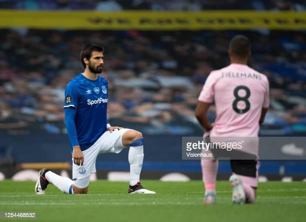 Andre Gomes of Everton and Youri Tielemans of Leicester City take a knee in respect of the Black Lives Matter campaign before the Premier League...
