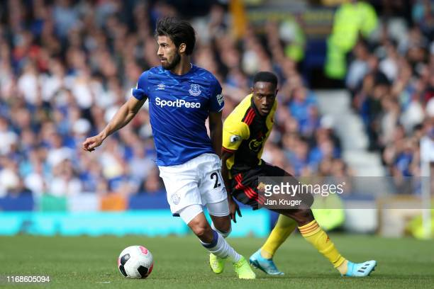 Andre Gomes of Everton battles for possession with Danny Welbeck of Watford during the Premier League match between Everton FC and Watford FC at...