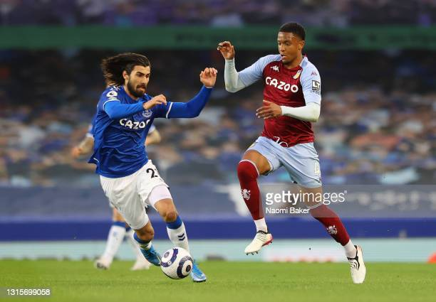Andre Gomes of Everton battles for possession with Ezri Konsa of Aston Villa during the Premier League match between Everton and Aston Villa at...