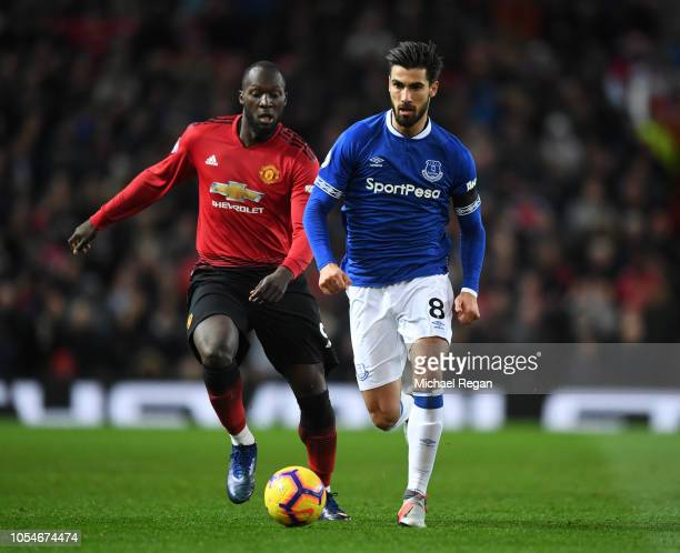 Andre Gomes of Everton battles for possession with Romelu Lukaku of Manchester United during the Premier League match between Manchester United and...