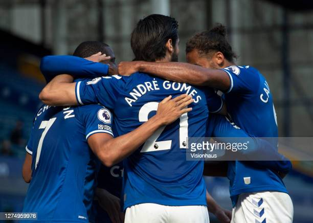 Andre Gomes of Everton celebrates with team mates after James Rodriguez scores the second goal during the Premier League match between Everton and...