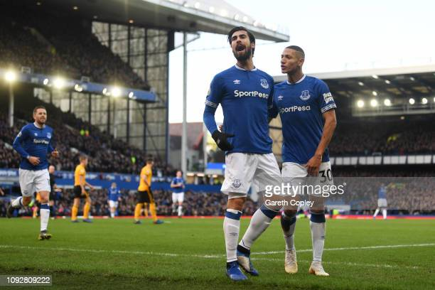 Andre Gomes of Everton celebrates with teammate Richarlison of Everton after scoring their team's first goal during the Premier League match between...