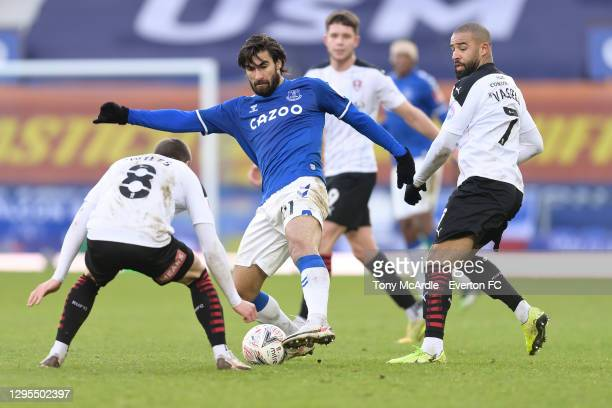 Andre Gomes of Everton challenges for the ball with Ben Wiles and Kyle Vassell during the FA Cup Third Round match between Everton and Rotherham...