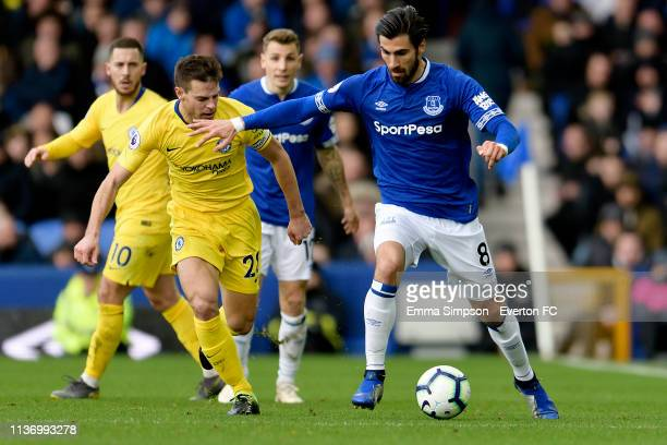 Andre Gomes of Everton challenges for the ball with Cesar Azpilicueta during the Premier League match between Everton and Chelsea at Goodison Park on...