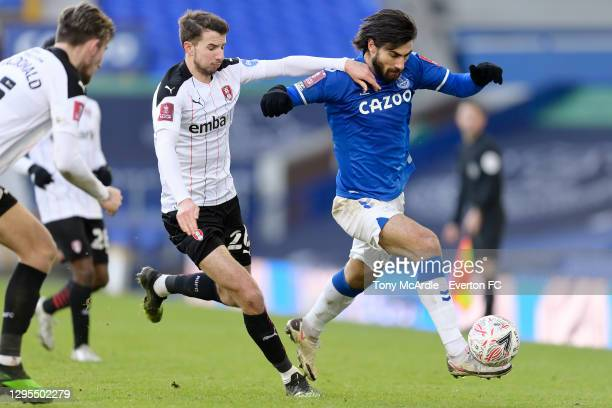 Andre Gomes of Everton challenges for the ball with Dan Barlaser during the FA Cup Third Round match between Everton and Rotherham United at Goodison...